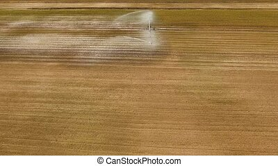 Irrigation system on agricultural land. - Aerial view: Crop...