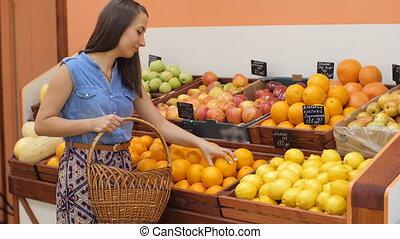 Woman Buying Oranges