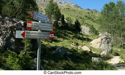 Sign indicating trail on the mountain in Valmalenco,...