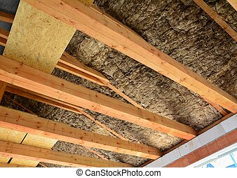 Roof insulation - Roof and attic insulation over wooden...
