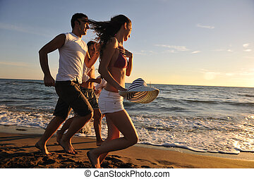 people group running on the beach