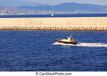Pilot Boat Past Barcelona Seawall in Blue Water
