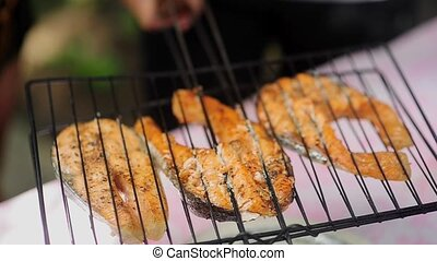Cooking grilled fish at sunny day