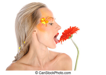 Young woman licks flower