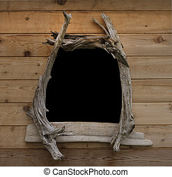 Window framed in driftwood on cedar shed - Cedar shed wall...