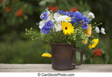 northern summery bouquet of cornflowers, flax capsules and...