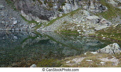 Small isolated alpine lake on the Bergamo Alps, northern...