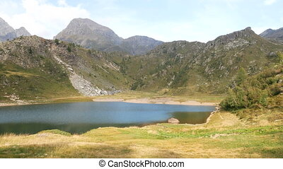 Panoramic view of small alpine lake on the Bergamo Alps,...