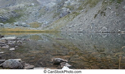 Small pure alpine lake on the Bergamo Alps, northern Italy