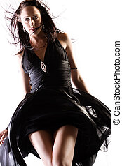 Billowing dress - Fashion model in studio with billowing...