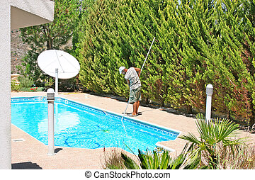 Swimming pool cleaner during his work