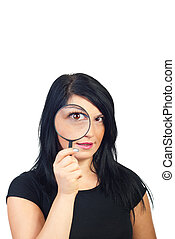 Spying woman - Funny woman holding magnifying glass and...