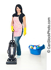 Cute woman using vacuum cleaner