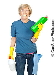 Senior woman holding cleaning products - Smiling senior...