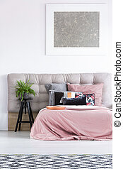 Bed with black pillow - Silver painting above to bed with...