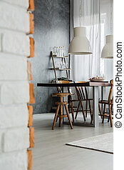 Dining room with dark wall - Close-up of industrial dining...