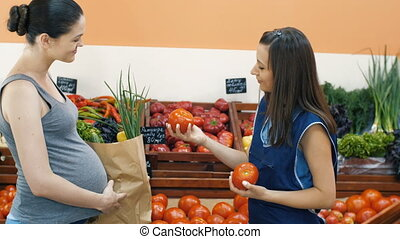 Pregnant Woman at Vegetable Market - Young woman at the...