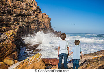Two boys standing on Cape of Good Hope - The concept of...