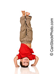 Child standing on a head - Child standing on his arms, yoga