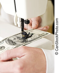 Sewing a dollar bank note - Dollar bank note in a sewing...