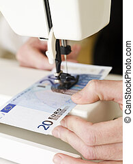 Sewing a Euro bank note - Euro bank note in the sewing...