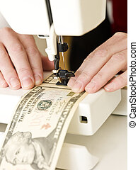 Sewing money - Ten dollar bank notes in a sewing machine