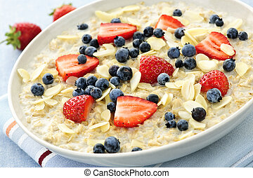 Oatmeal breakfast cereal with berries - Bowl of hot oatmeal...