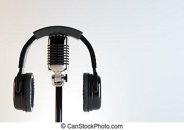 Headphones and mic, earphones concept - Black headphones and...