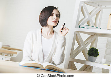 Charming business woman doing paperwork - Portrait of...