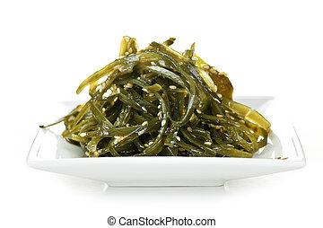 Seaweed salad - Plate of wakame seaweed salad on white...