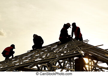 Contractor in Silhouette working on a Roof Top
