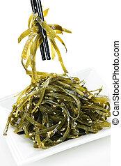 Seaweed salad - Plate of wakame seaweed salad with...