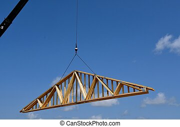 Transferring trusses(rafters) to the top of a building under...