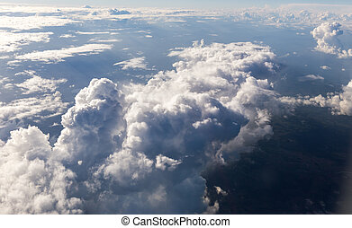 Puffy Clouds from Above - Puffy clouds seen from an...
