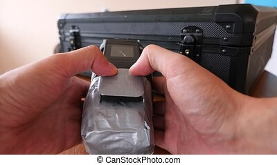 A man puts a homemade explosive device in his suitcase....