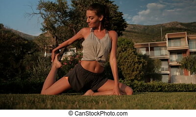 Athlete woman doing stretching exercises fitness on vacation...