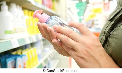 woman chooses shopping in the store household chemicals and...