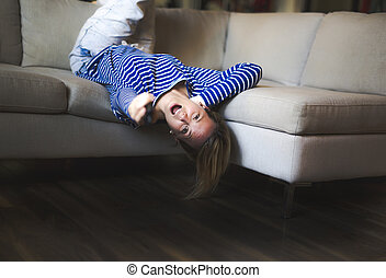 woman sitting on the couch take some good time upside down -...