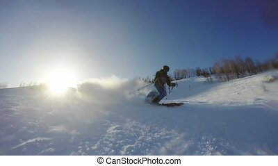 Extreme skier spraying snow in slow motion in sunny mountain...
