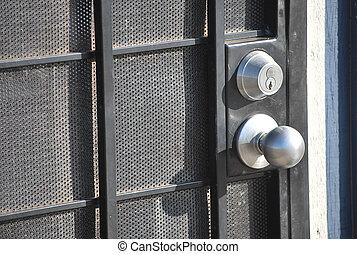 Door lock with a round metal handle on the door.