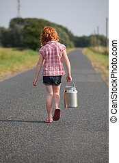 Young girl with milk can - Red-haired girl with milk can on...
