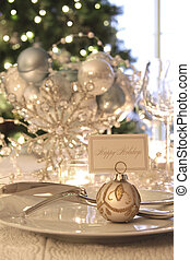 Elegant holiday dinner table with focus on place card -...