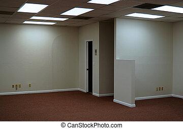 empty office space - inside empty office space lit by...
