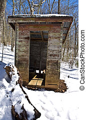 Old Outhouse in the Snow - This outhouse, with two seats, is...
