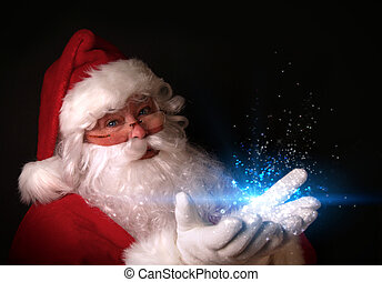 Santa holding magical lights in hands - Christmas theme with...