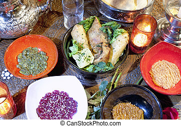 Moroccan cuisine - Different moroccan dishes with candles on...