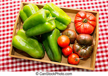 Small wooden crate with vegetables from the garden - a small...