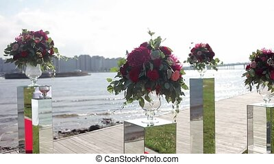 The design of weddings. Bouquet of red flowers. Outdoor -...