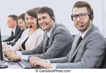 customer service representative with headset in call center...