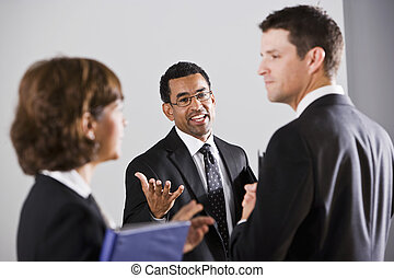 Diverse businesspeople conversing - African American...